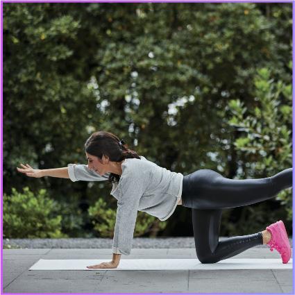 Christine performing yoga